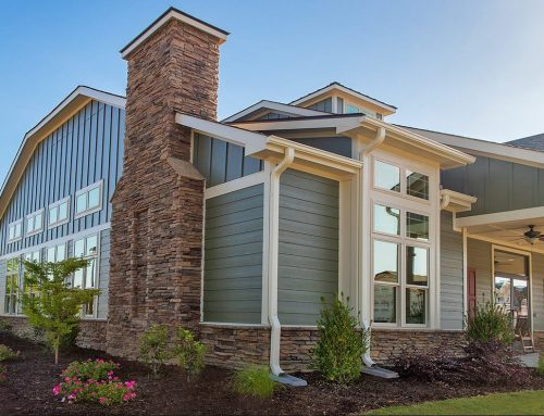 Eye-catching stone veneer on subdivision's clubhouse, community fireplace, and townhomes